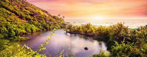 Tropical view to the Sweet Lake on Arambol beach at purple sky in Goa, India