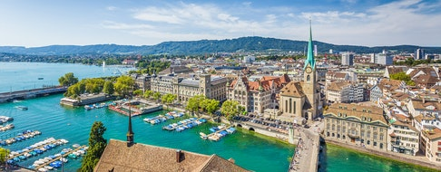 Zurich city center with famous Fraumunster Church and river Limmat at Lake Zurich from Grossmunster on a sunny day with blue sky, Canton of Zurich, Switzerland