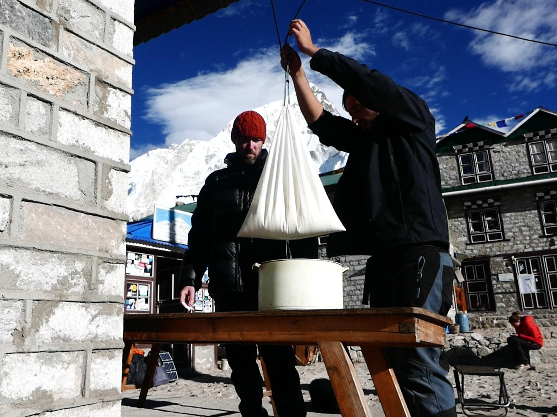 James and Kevin making yogurt on Everest.