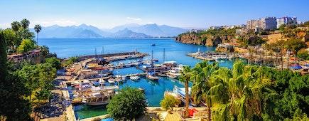 Panoramic view of Antalya Old Town port, Taurus mountains and Mediterrranean Sea, Turkey