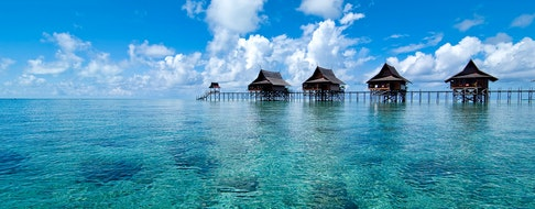 A man-made Kapalai island exotic tropical resort in the middle of ocean of clear water