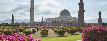 Garden view of the Sultan Qaboos Grand Mosque in Muscat, Oman