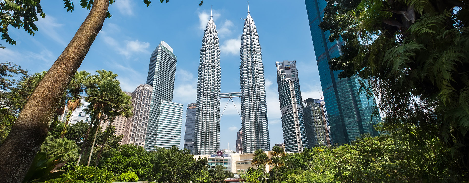 Famous Petronas Twin Towers captured from KLCC Park City Centre in Kuala Lumpur, Malaysia