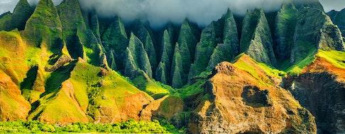 Na Pali coast, Kauai, Hawaii view from sea sunset cruise tour. Nature coastline landscape in Kauai island, Hawaii, USA. Hawaii travel