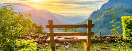 A bench with a view of the beautiful mountain valley at dawn. Ella, Sri Lanka