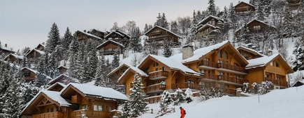 View of cottages and chalets in a ski resort in French Alps, France