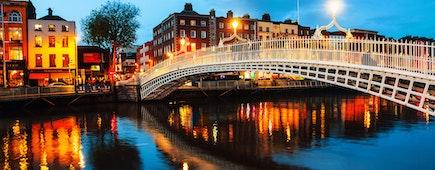 Dublin, Ireland. Night view of famous illuminated Ha Penny Bridge in Dublin, Ireland