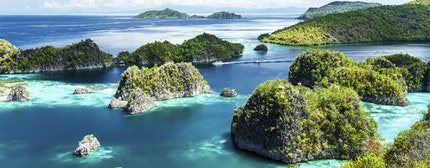 scattered islands over clear blue ocean, Painemo, Raja Ampat, West Papua