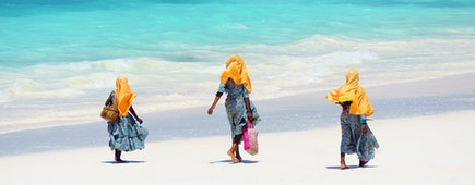 Kids walking on the beach in Zanzibar Tanzania