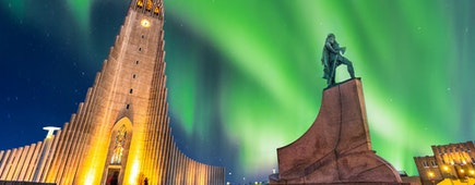 aurora borealis above hallgrimskirkja church in central of reykjavik city in Iceland