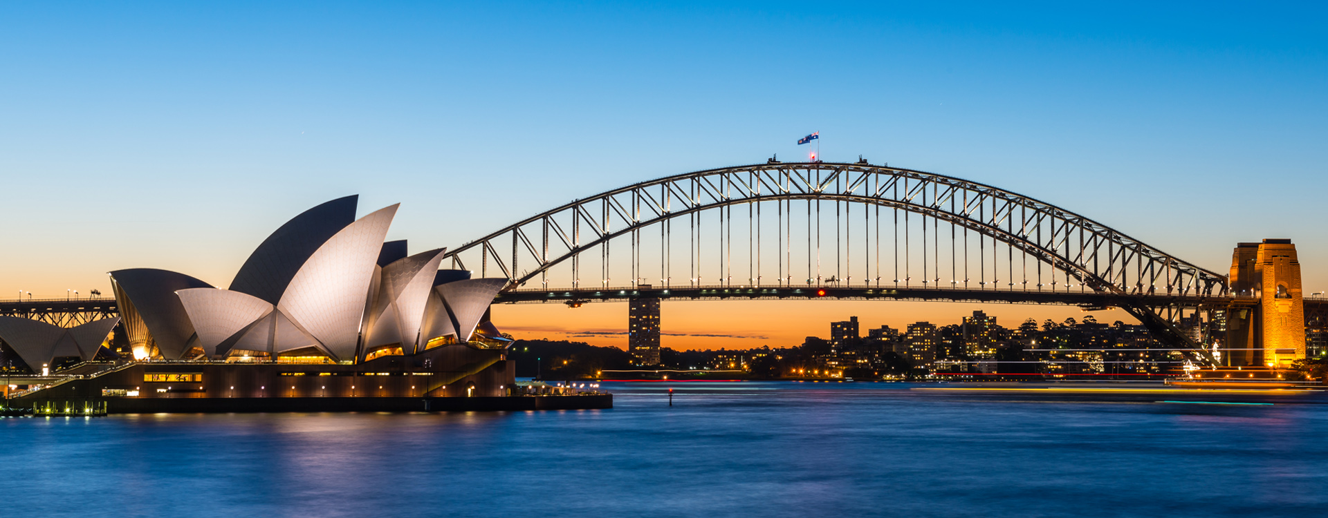 The Sydney Opera House with Harbour bridge in Sydney Australia, Designed by Danish architect Jorn Utzon