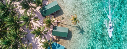 Tobacco Caye aerial in Belize barrier reef with boat