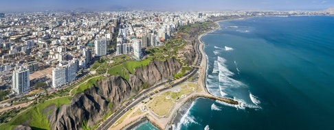 LIMA, PERU: Aerial view of Miraflores town, cliff and the Costa Verde high way.