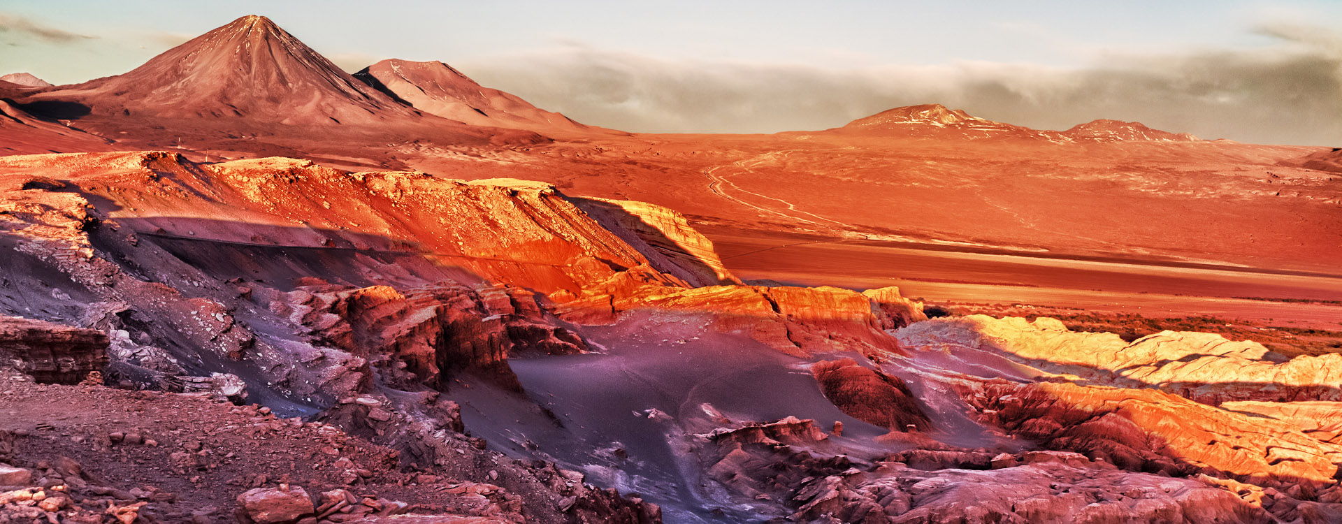 Sunset in front of the volcano and the salt desert