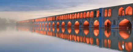 Historical Siosepol Bridge in Isfahan and its reflection in water, Iran