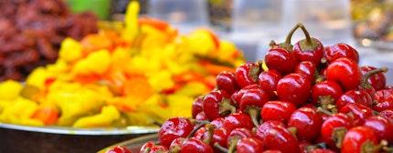 Pickled vegetables, tomatoes on display in food market in Tel Aviv, Israel