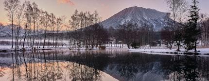 Mountain Yotei and reflective lake in Hokkaido Japanat dusk