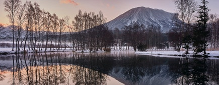 Mountain Yotei and reflective lake in Hokkaido Japanat dusk