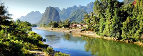 Surreal landscape by the Song river at Vang Vieng, Laos
