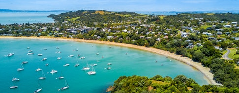 Bay at sunny day with sandy beach and residential suburbs, Waiheke Island, Auckland, New Zealand