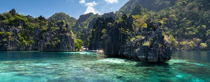 Famous Lime rocks of Coron island and clear blue waters Busuanga Palawan Philippines