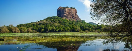 Sigiriya Rock Fortress, seen from Sigiriya Lake in the cultural triangle of Sri Lanka, Asia