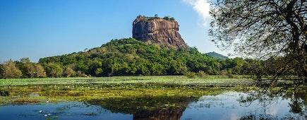 Sigiriya Rock Fortress, seen from Sigiriya Lake in the cultural triangle of Sri Lanka, Asia