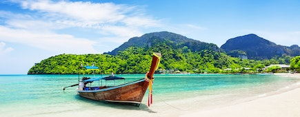 Thai traditional wooden longtail boat, beach at Koh Phi Phi island in Krabi, Thailand
