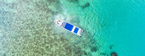 Aerial view of beach with boats, Koh Phangan, Thailand