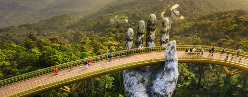 The Golden Bridge is lifted by two giant hands on Ba Na Hill in Danang, Vietnam