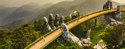 Famous Golden Bridge lifted by two giant hands on Ba Na Hill in Da Nang, Vietnam