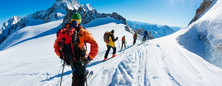 skiers start the descent of Valle Blanche, the most famous offpist run in the Alps. Chamonix, France, Europe.