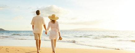 Happy Romantic Middle Aged Couple Enjoying Beautiful Sunset Walk on the Beach