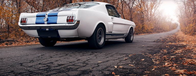 Old car Ford Mustang Shelby GT350 on the road at daytime