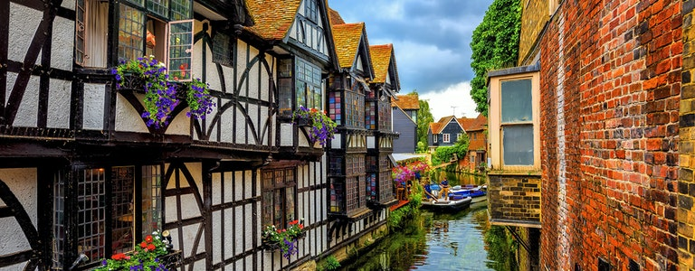 Medieval half-timber houses and Stour river in Canterbury Old Town, Kent, England