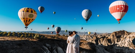 Honeymoon trip in Cappadocia,Turkey. Flying balloons at sunrise
